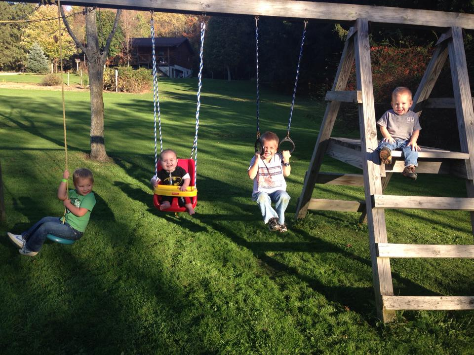 Judah swinging with his cousins today
